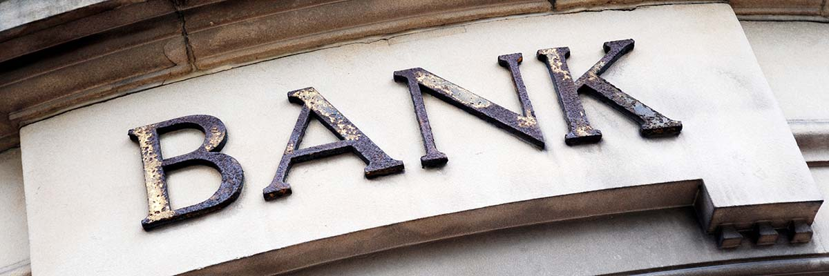 Large sign that says bank on front of building
