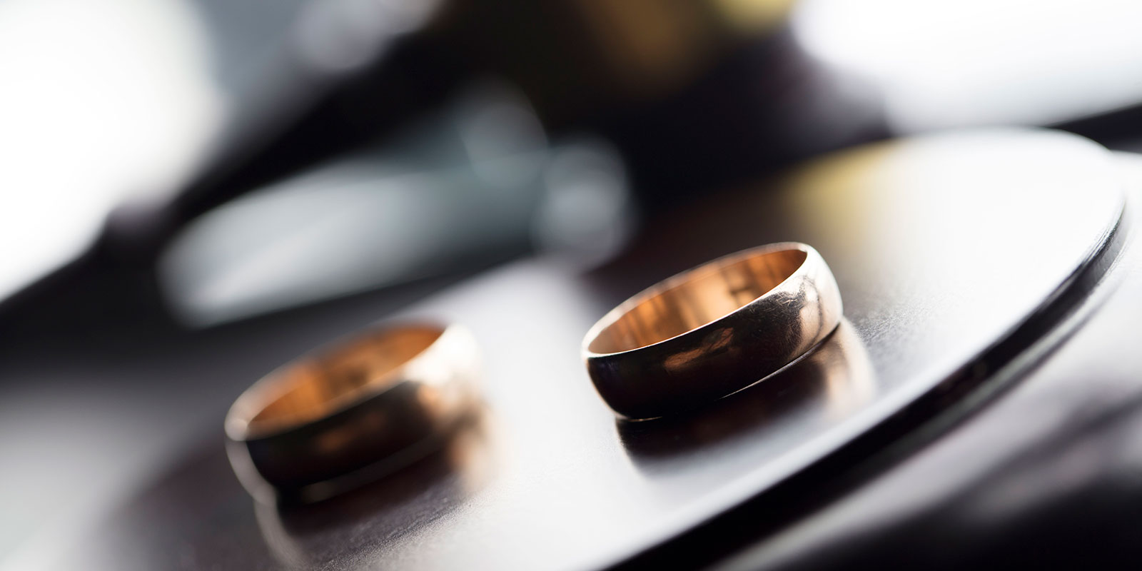 Two separated rings on a table.