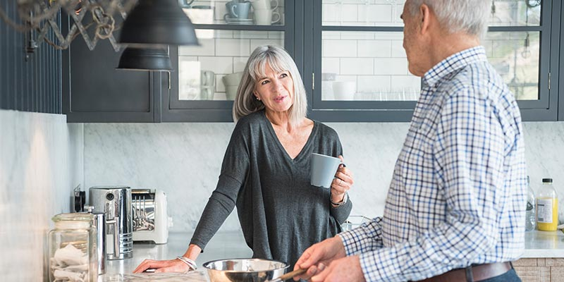 Couple discussing plans in kitchen